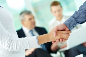 9726993 - photo of handshake of business partners after striking deal