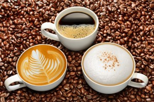 42528010 - variety of cups of coffee on coffee beans background