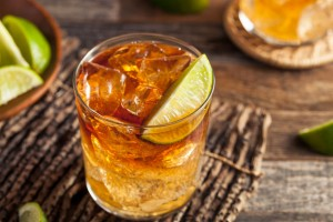 53105649 - dark and stormy rum cocktail with lime and ginger beer
