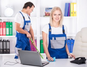 33967989 - young couple professional cleaners are cleaning the office.