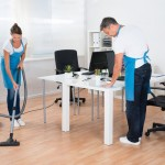 48131542 - two professional janitors are cleaning the modern office