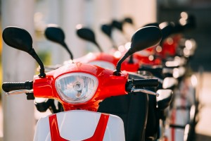 99422510 - many electric motorbikes, motorcycles scooters parked in row in city